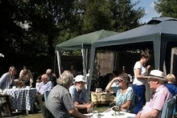 People enjoying a sunny garden party